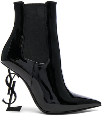 Saint Laurent Patent Opium Monogramme Heeled Boots in Black & Black | FWRD