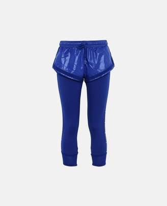 adidas by Stella McCartney Stella McCartney blue essential shorts over tights