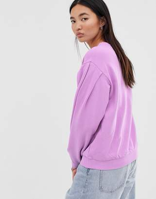 Asos Design DESIGN oversized sweatshirt in washed neon lilac