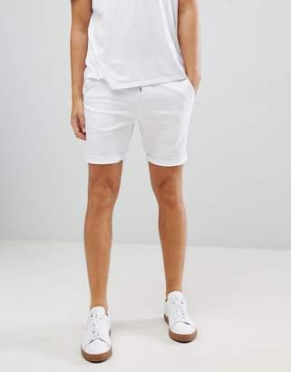 Asos DESIGN skinny chino shorts in white