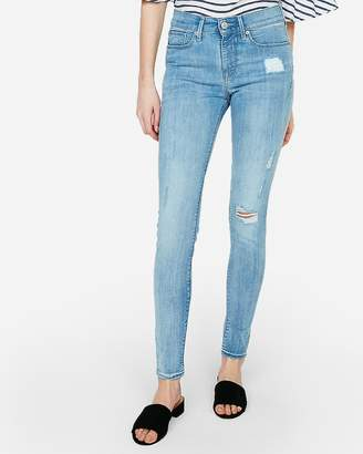 a521527aa3 Express Mid Rise Light Wash Ripped Jean Leggings
