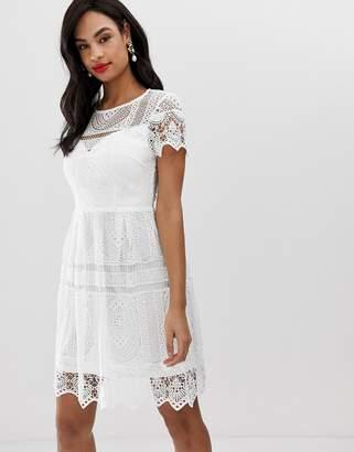 Liquorish lace overlay mini dress with open back