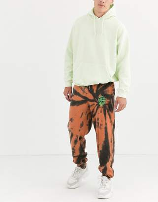 Entente joggers in orange and black tie dye