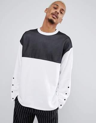 Asos DESIGN oversized longline sweatshirt with mesh panel and popper sleeves