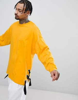 Asos Oversized Long Sleeve T-Shirt With Chunky Eyelet Seam Detail In Yellow