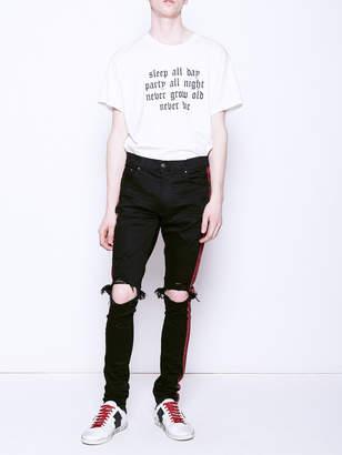 Amiri Glitter stripe track jeans