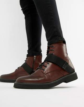 Asos Design DESIGN lace up boots in burgundy leather with chunky sole and strap detail