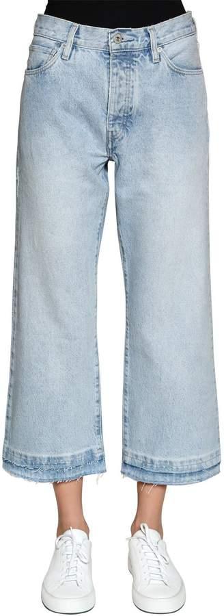 Kürzere, Ausgestellte Jeans Aus Denim
