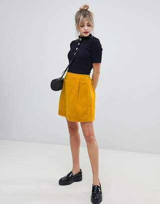 Asos DESIGN tailored cord mini skirt in mustard