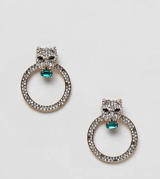 Aldo leopard head rhinestone hoop earrings with emerald stones