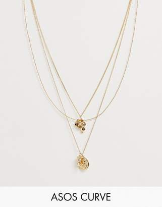 Asos DESIGN Curve multirow necklace with gardenia and cupid pendants in gold