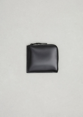 Comme des Garcons PLAY black leather half zip wallet $195 thestylecure.com