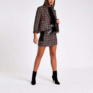 River Island Red check faux leather block mini skirt