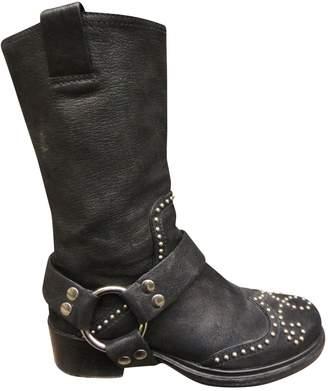 Miu Miu Leather buckled boots