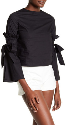 Haute Rogue Ruffle Bell Sleeve Blouse $100 thestylecure.com