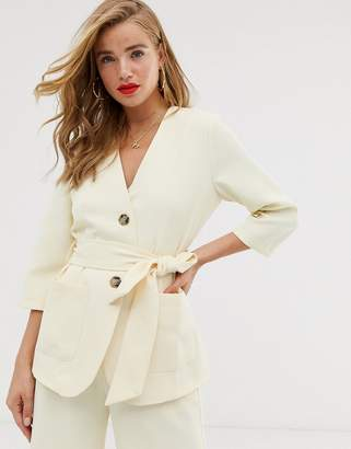 In The Style x Laura Jade tie waist cropped sleeve jacket in cream