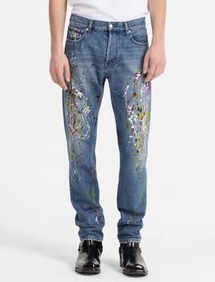 Calvin Klein slim leg paint splatter jeans