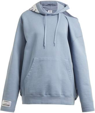 Vetements Hooded open-shoulder sweatshirt