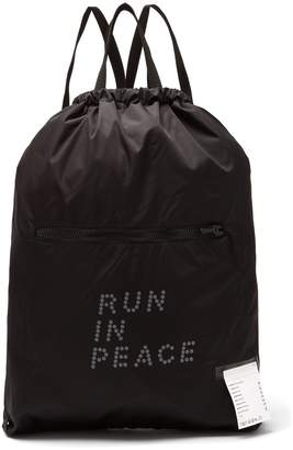 Satisfy Run In Peace waterproof backpack