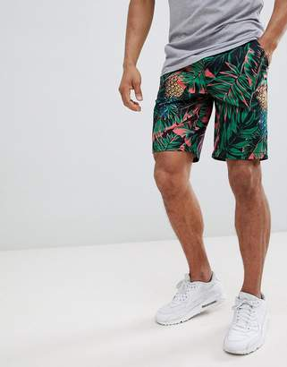 Asos DESIGN Slim Shorts In Abstract Pineapple Palm Print