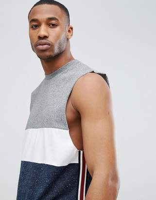 Asos DESIGN sleeveless t-shirt with curved hem in intrest fabric color block and contrast side taping