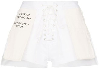 Unravel Project Slogan distressed denim shorts