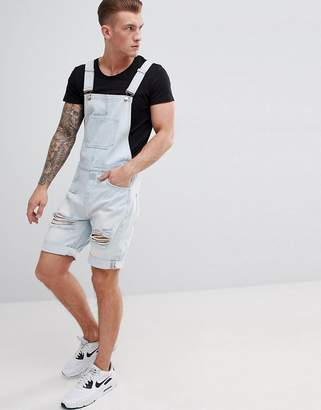 Asos Design Denim Short Dungarees In Light Wash Blue With Heavy Rips