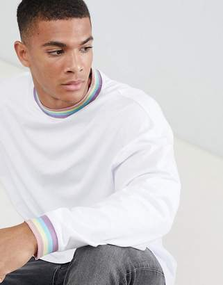 Asos DESIGN oversized longline long sleeve t-shirt with rainbow neck and cuff in white