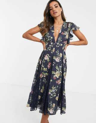 Asos Design DESIGN midi dress with godet lace inserts in navy based floral