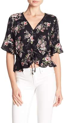 Angie 3\u002F4 Sleeve Front Tie Floral Print Blouse