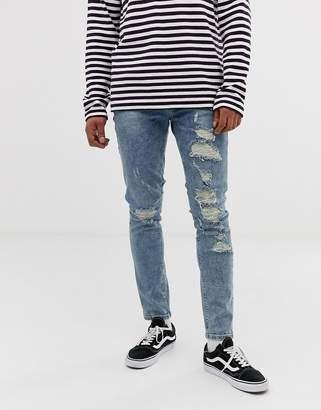 Asos DESIGN skinny jeans with mega rips in light blue