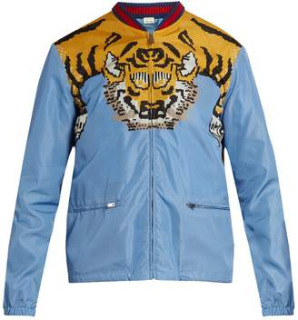 GUCCI Tiger-print shell bomber jacket $1,400 thestylecure.com