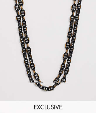 Reclaimed Vintage inspired layered chain interest in black and gold exclusive to ASOS
