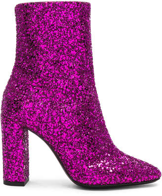 Saint Laurent Glitter Lou Ankle Boots in Fuchsia | FWRD