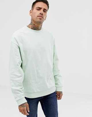 Asos DESIGN oversized sweatshirt in pale green