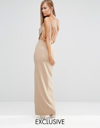 Fame and Partners Sleek Maxi Dress with Faux Pearl Back $275 thestylecure.com
