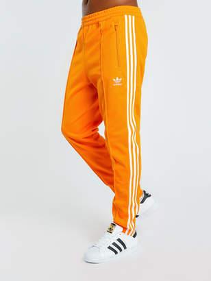 promo code 514dd ae62b adidas Beckenbauer Track Pants in Bright Orange