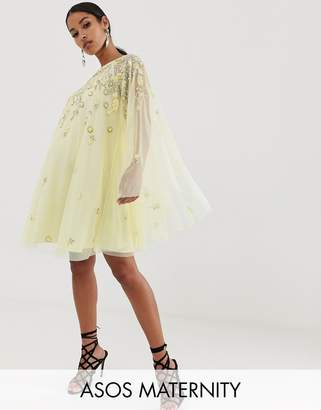 Asos DESIGN Maternity mini dress with heavily embellished cape