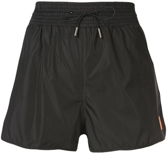 Off-White flared runner shorts