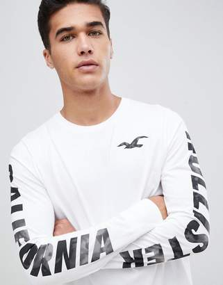 Hollister long sleeve top large seagull and sleeve logo in white