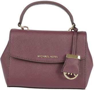 Ava Medium Shoulder Bag From Michael Kors: Plum Ava Medium Shoulder Bag With Top Handle, Front Logo Plaque, Handle Gold-tone Logo With Leather Cover, $152 thestylecure.com