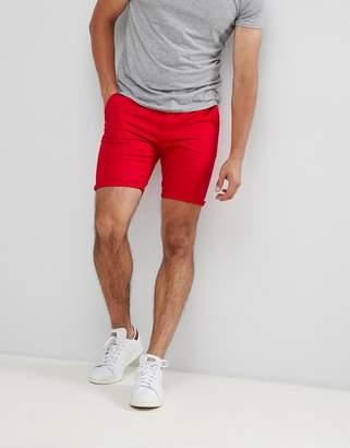 Asos DESIGN skinny chino shorts in red