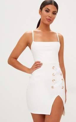 PrettyLittleThing White Eyelet Satin Lace Up Detail Plunge Mini Dress