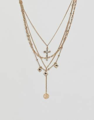 Asos DESIGN multirow necklace with vintage style cross and coin pendants in gold