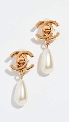 Chanel What Goes Around Comes Around Gold Pearl Turnlock Earrings