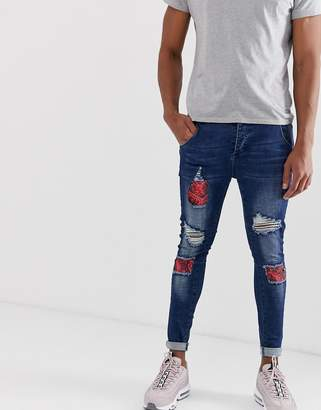 SikSilk distressed jeans with floral patch in dark blue