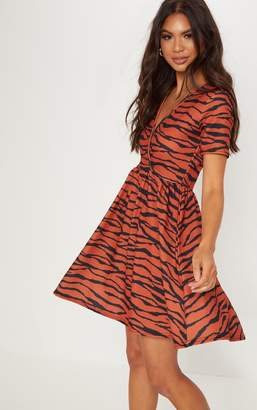 PrettyLittleThing Burnt Orange Zebra Print Wrap Front Skater Dress ad290ea28