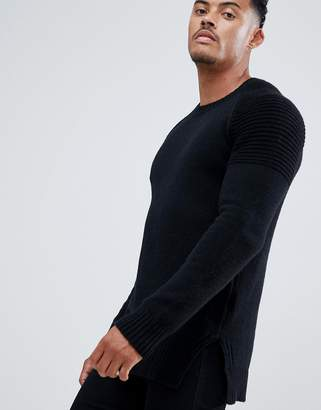 Religion sweater in black with biker style sleeves