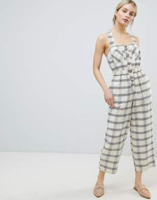 Asos Design DESIGN Jumpsuit With Elasticated Waist And Button Detail In Check