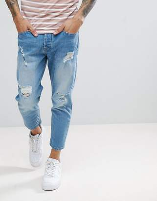 Solid Tapered Cropped Jeans With Rips In Light Blue